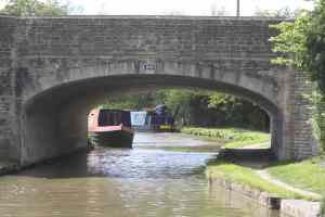 The red boat's moored on a bend in the bridge - the hire boat's grounded; we got through without any drama - phew!