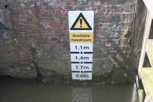 The headroom warning below Nell Bridge Lock - hard to imagine this calm river rising into to such a raging torrent.