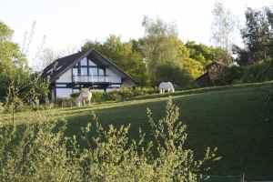 Good looking house overlooking the mooring at Radford Semele.