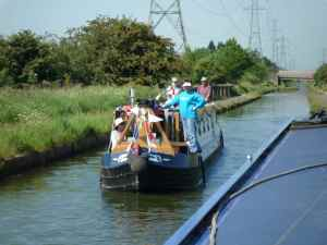 The cheery crew of nb Elemiah on the Tame Valley Canal