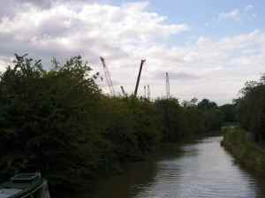 Stratford Canal: Industrial Stratford - yard full of cranes waiting to be shipped out