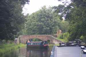 Interesting structures at Aldersley Junction (and the boat beginning her blocking manoeuvre!)