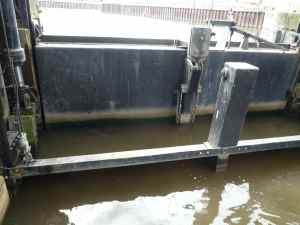 Then they pump out the water between the caisson gate and the river gate...