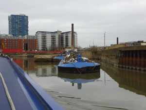 Haphazard raft of rubbish barges - not far from the entrance to the Bow Back Rivers...