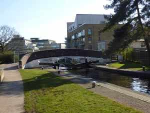 "Uxbridge Lock, with its traditional turnover bridge, is something of a boundary between the urban and ""rural"" Grand Union.."
