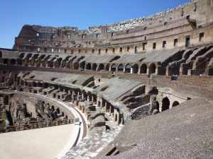 "The interior of the Coliseum - the flat ""stage"" to the bottom left of the photo is the partially restored arena floor - the sub structures held the cages/cells/barracks for those taking part, as well as elaborate stage mechanisms e.g. trapdoors"