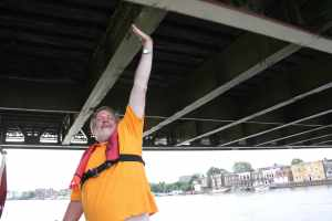 The headroom under Hammersmith Bridge is severely reduced at high tide - nothing to bother a narrowboat though :-)
