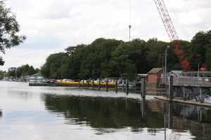 We like to see the water being used for freight - in this case a barge full of what looked like large pipe sections being manoeuvred into place very skilfully above Molesey lock...
