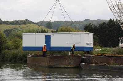 No that's a sight you don't often see - this cabin was being loaded onto the barge - who knows why??