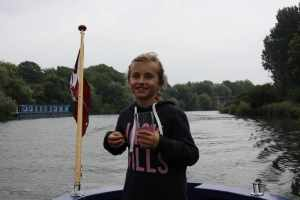 What a trooper! Ella was a natural on the helm and didn't seem to mind the rain..