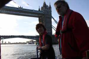 Alfie taking the helm for the obligatory photo under Tower Bridge...