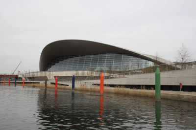 "The beautiful aquatic centre - along with the coloured ""bollards"" - looks like someone's planted a boxful of crayons in the water!"