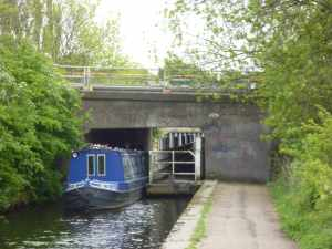Interesting bridge - wide beams can pass by arrangement - the towpath under the bridge can be unhitched and parked off to one side...