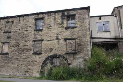 Some of these old industrial buildings have fearsome cracks in their masonry with some massive reinforcement to keep them standing....