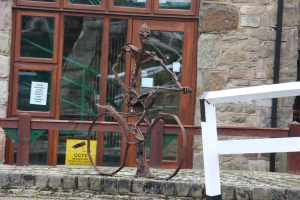 Sculpture at the service point in the Blackbrun flight - he ooks very miserable, but then he is cycling with uneven wheels over cobbles - ouch! :-)
