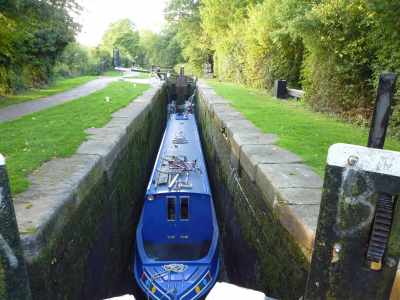 This section of canal has deep narrow locks with a fierce draw forward once the paddles are opened...
