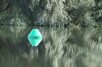 The photo doen''t do justice to how surreal the buoys and their reflections looked -